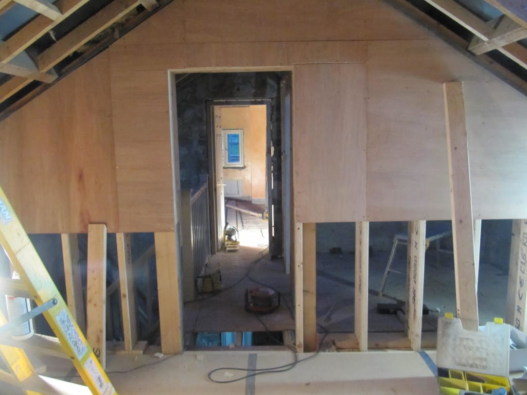 Doorways within roof trusses at Cumberworth radical retrofit