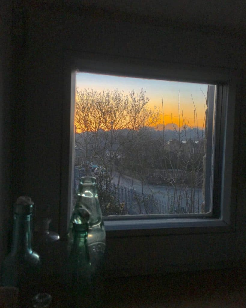 52. Daybreak through the smallest window in our house - the frame emphasising the feeling of isolation but the colour in the sky giving hope. Submitted by Kate Tunstall