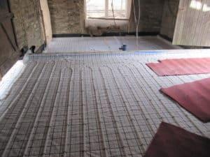 Underfloor heating at Lower Royd radical retrofit