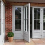 PERFORMANCE French doors at Arts and Crafts house Sussex