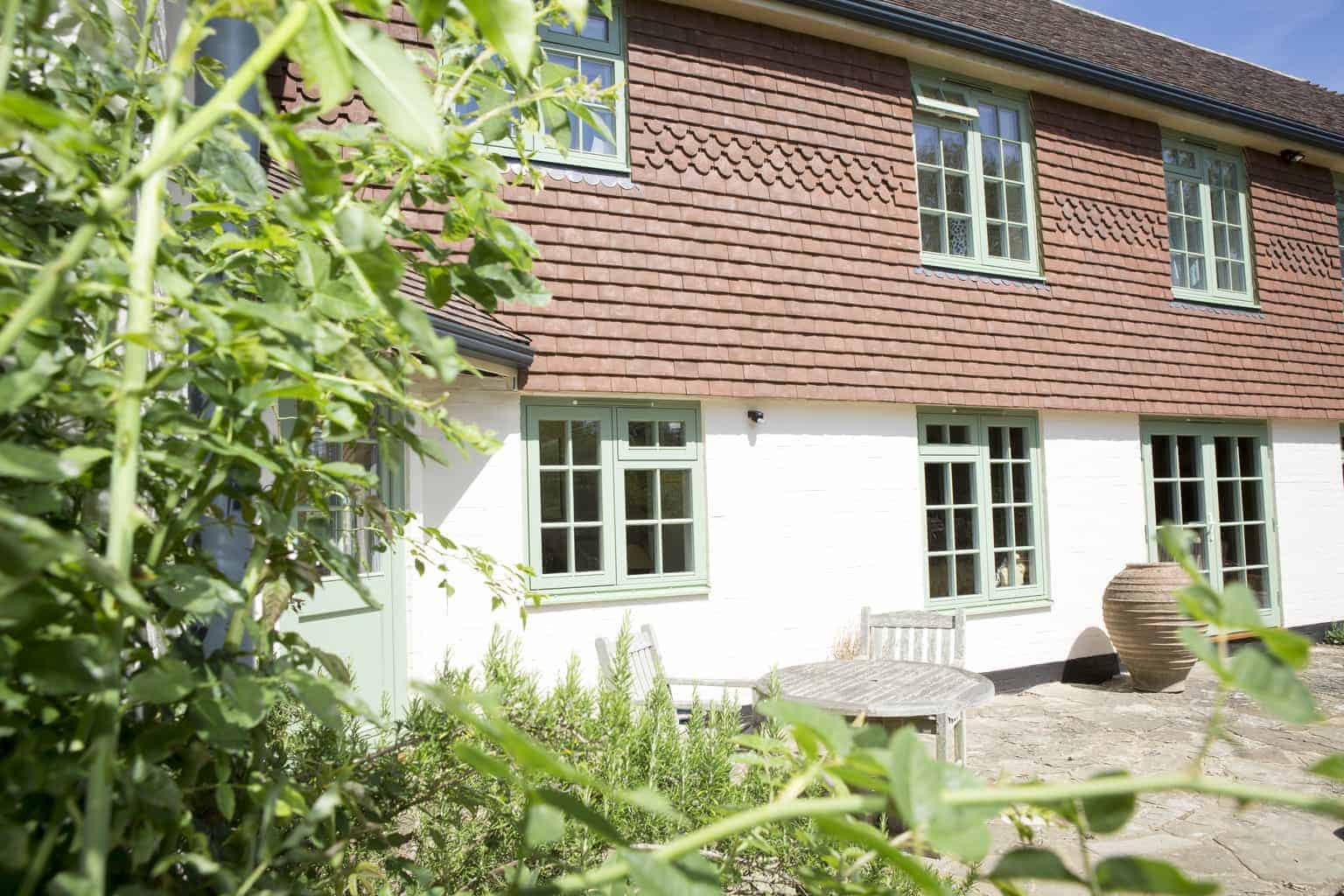 PERFORMANCE triple glazed timber windows with interstitial glazing bars at Sussex low energy retrofit