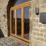 Green Building Store PERFORMANCE triple glazed timber bi-fold fold-aside doors