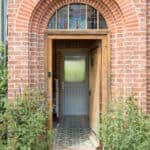 PERFORMANCE triple glazed timber door (seen through oak external door) at The Orchard - Arts and Crafts low energy newbuild - photograph Adam Scott