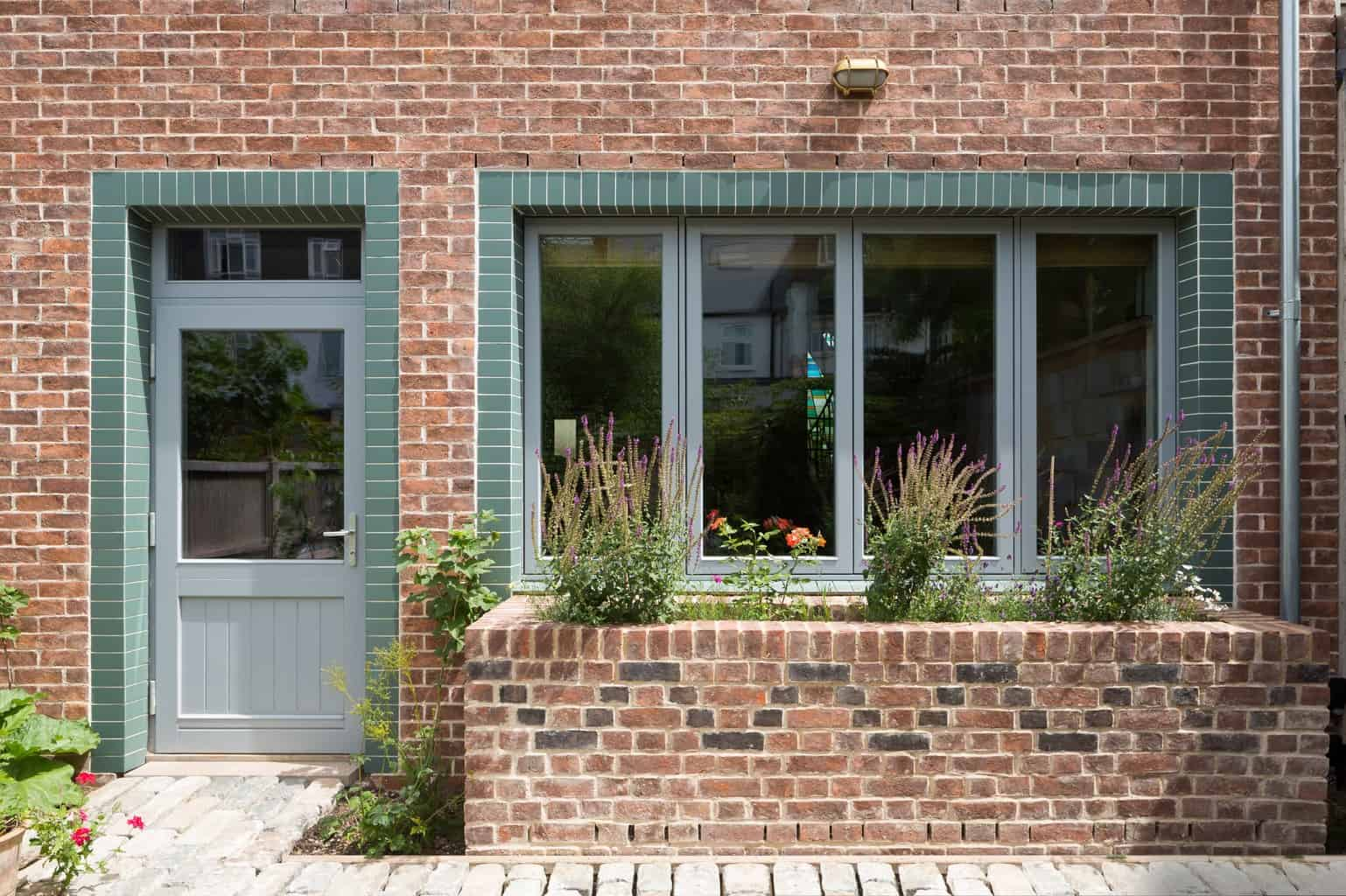 PERFORMANCE triple glazed timber windows and door at The Orchard - Arts and Crafts low energy newbuild - photograph Adam Scott