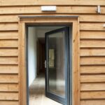 ULTRA triple glazed timber entrance door at PYC Group Passivhaus Office Welshpool
