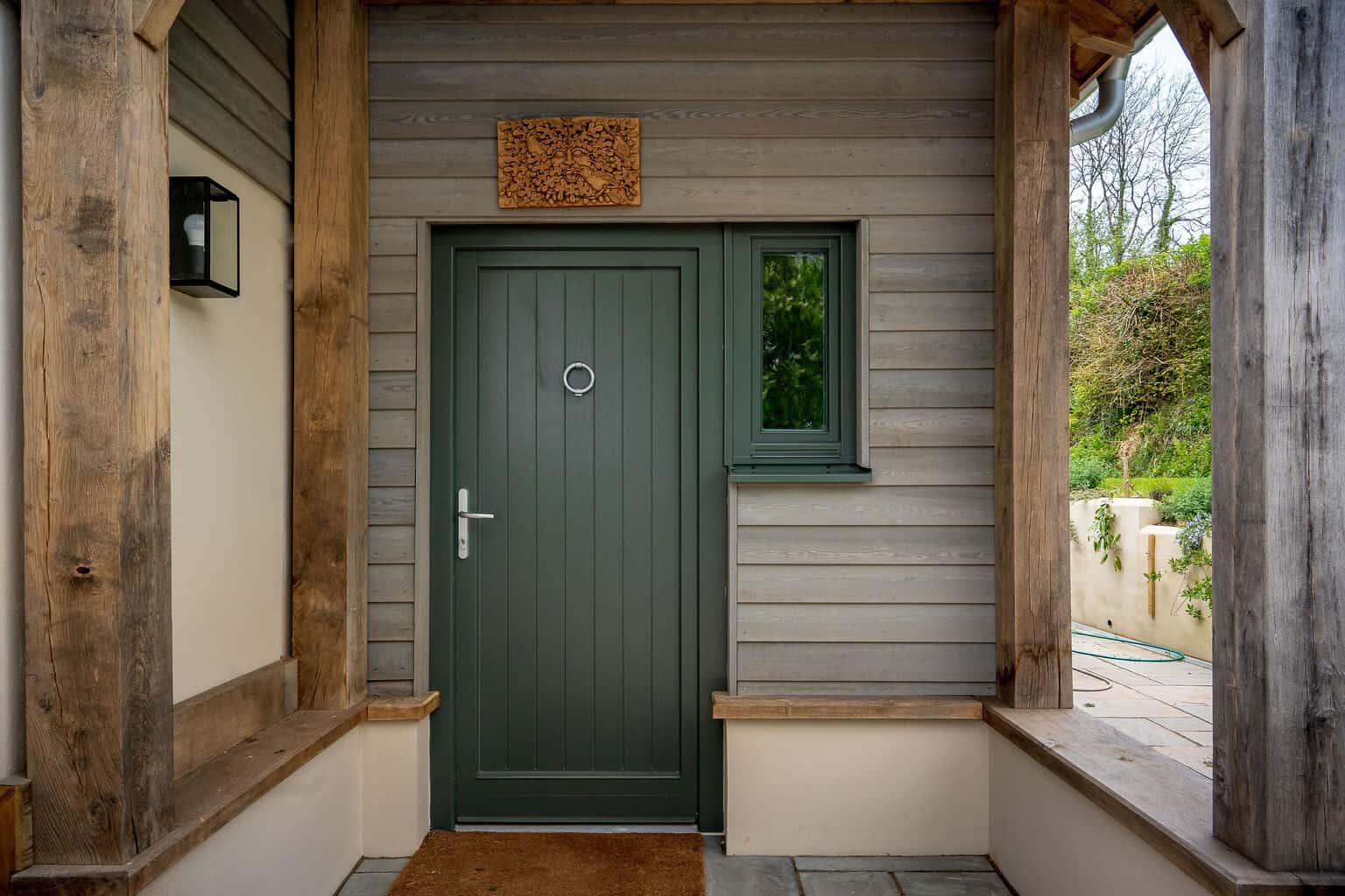 ULTRA triple glazed timber window and entrance door at oak frame newbuild Devon