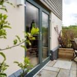 ULTRA triple glazed timber French doors at oak frame newbuild Devon